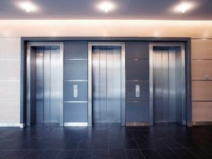 Outside view of three elevator doors.